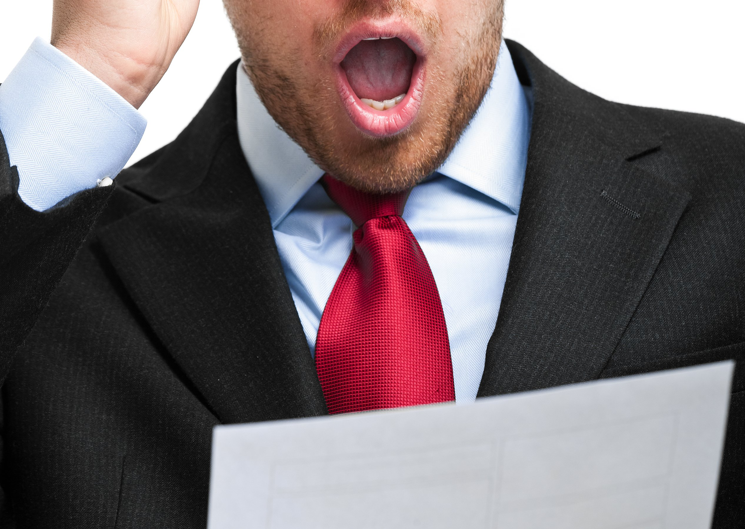 A man with a document shows surprise at reading Unexpected Employee Engagement Survey Results
