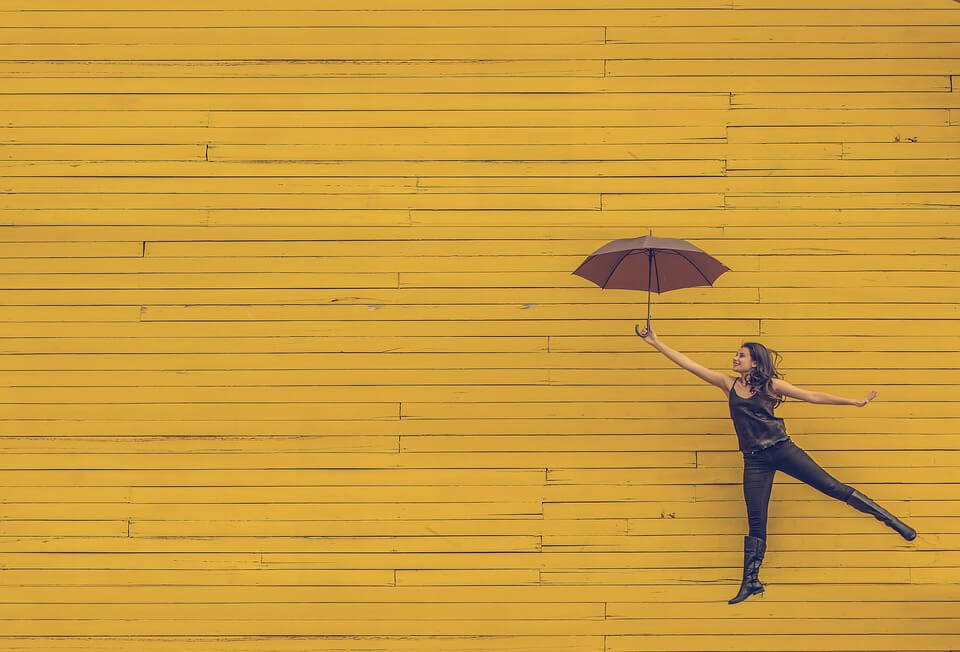 A woman with an umbrella to Make Employee Engagement Personal